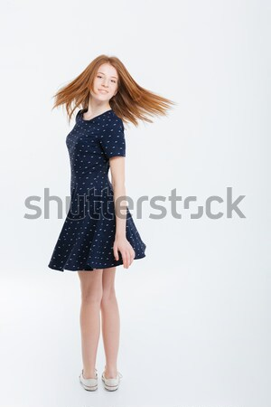 Happy beautiful woman looking back at  camera Stock photo © deandrobot