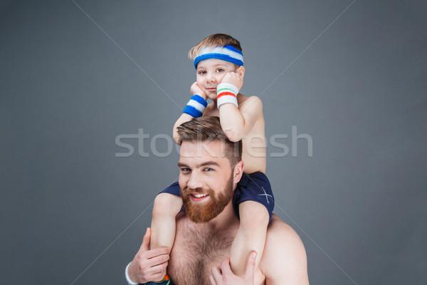 Boldog szakállas férfi kicsi fiú ül Stock fotó © deandrobot