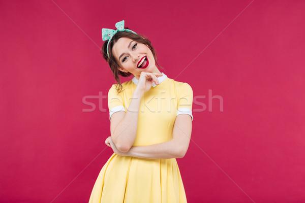 Wesoły piękna pinup dziewczyna żółty sukienka Zdjęcia stock © deandrobot