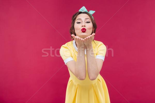 Boldog csinos pinup lány citromsárga ruha Stock fotó © deandrobot
