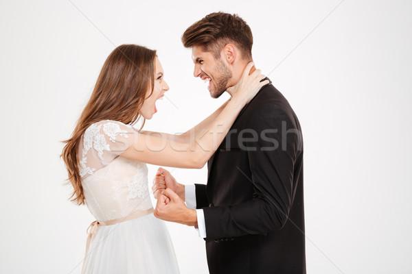 Girl strangling a Man Stock photo © deandrobot