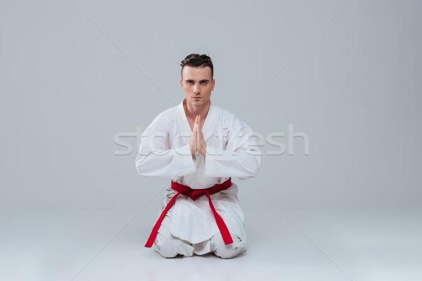 Yakışıklı genç oturma zemin kimono Stok fotoğraf © deandrobot