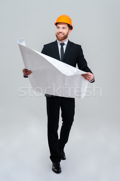 Full length engineer in suit with layout Stock photo © deandrobot
