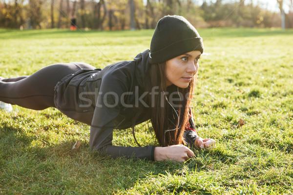фитнес Lady одежды наушники Сток-фото © deandrobot