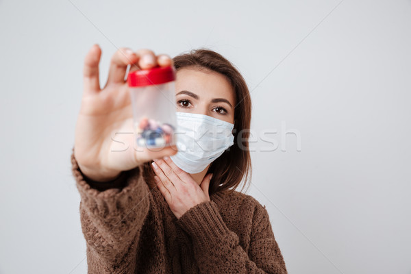 Stockfoto: Vrouw · trui · medische · masker · tonen