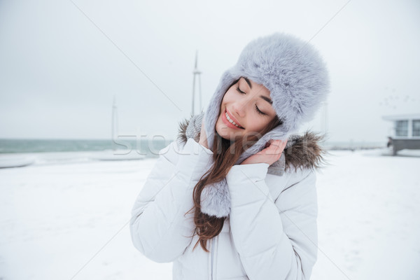 Gorgeous young woman wearing hat walking near beach Stock photo © deandrobot