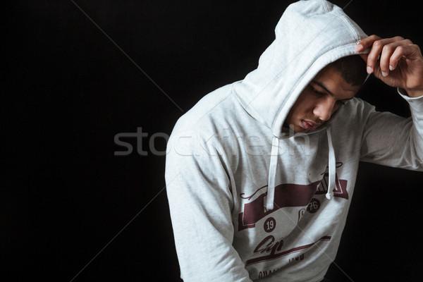 悲しい 失望した アフリカ 若い男 立って 思考 ストックフォト © deandrobot