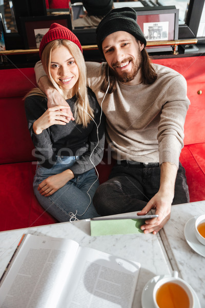 Vertical image of couple with tablet computer Stock photo © deandrobot