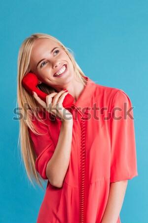 Mutlu sarışın kadın kırmızı elbise ayakta uçan saç Stok fotoğraf © deandrobot