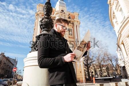 Yandan görünüş adam kat gazete gözlük eller Stok fotoğraf © deandrobot