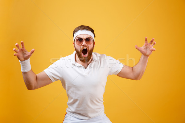 Shocked sportsman in sunglasses with open mouth Stock photo © deandrobot