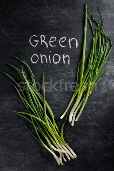 Fotoğraf yeşil soğan karanlık kara tahta üst görmek Stok fotoğraf © deandrobot