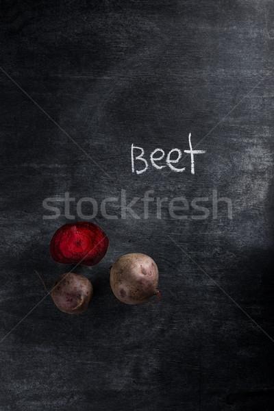 Beet over dark chalkboard background Stock photo © deandrobot