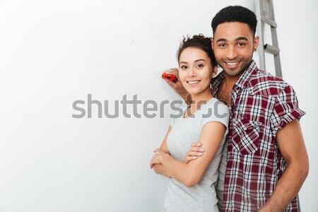 Portrait of couple with repair's equipment Stock photo © deandrobot