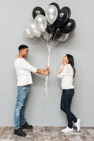 Man give to woman a lot of balloons. Stock photo © deandrobot