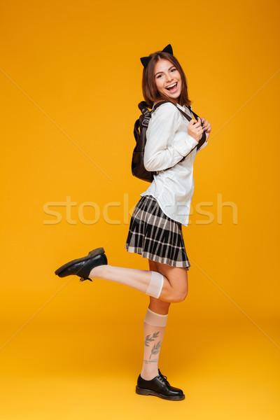 Retrato colegiala uniforme mochila Foto stock © deandrobot