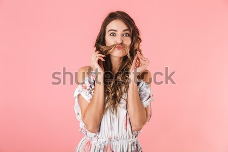 Surprised lady in casual clothes using smartphone isolated Stock photo © deandrobot