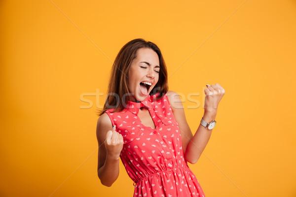 Bastante bem sucedido mulher jovem vestido vermelho as mãos levantadas Foto stock © deandrobot