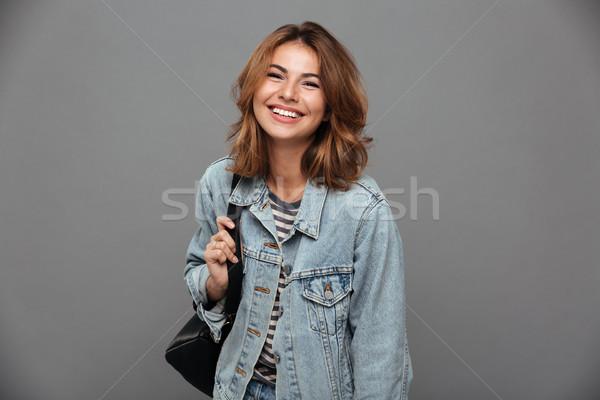 Porträt ziemlich Mädchen Denim Jacke halten Stock foto © deandrobot