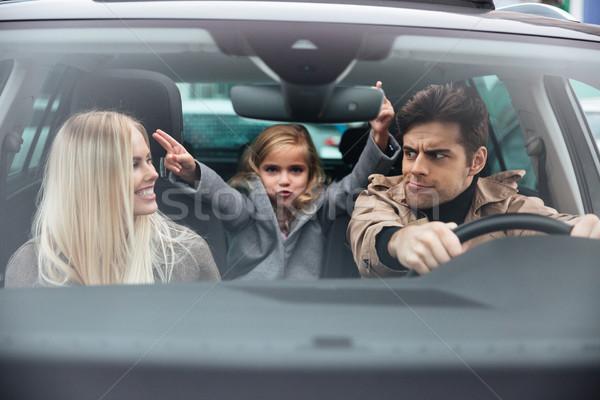 Joven sesión coche funny esposa Foto stock © deandrobot