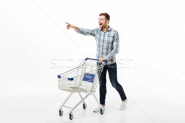 Tam uzunlukta portre heyecanlı adam yürüyüş Stok fotoğraf © deandrobot