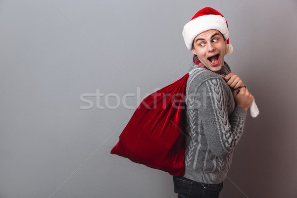 Widok z boku wesoły człowiek sweter christmas hat Zdjęcia stock © deandrobot