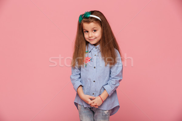 Portrait of cute schoolgirl 5-6 years having long auburn hair lo Stock photo © deandrobot