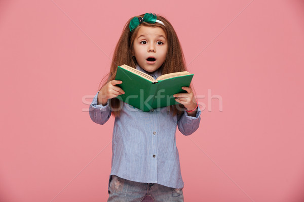 Attractive girl with european appearance holding book in hands e Stock photo © deandrobot