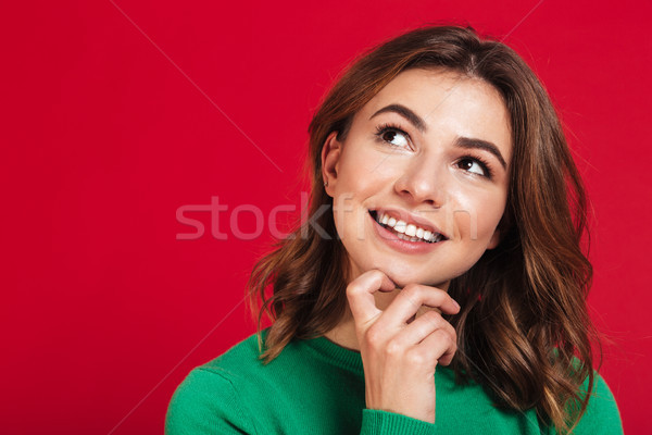Smiling dreaming young pretty woman standing isolated Stock photo © deandrobot