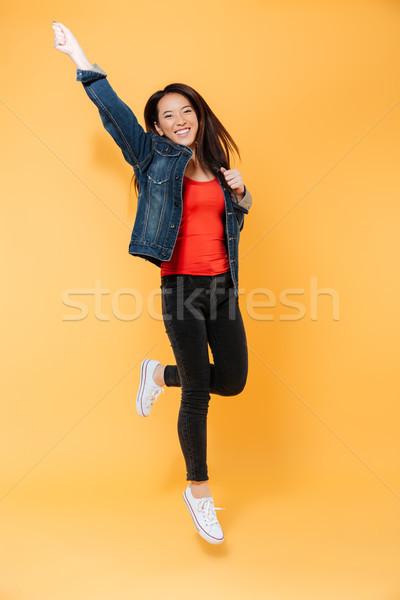 Obraz wesoły asian kobieta denim Zdjęcia stock © deandrobot
