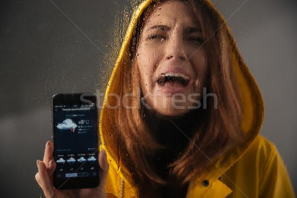 Pleurer fille imperméable tête permanent Photo stock © deandrobot