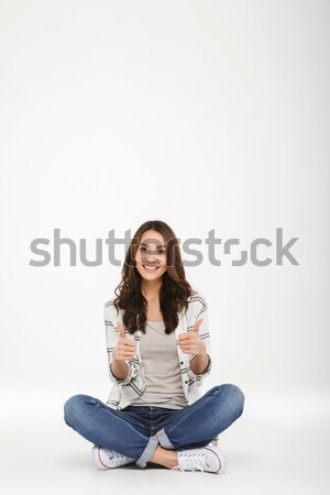 Vertical image of Smiling brunette woman in shirt Stock photo © deandrobot