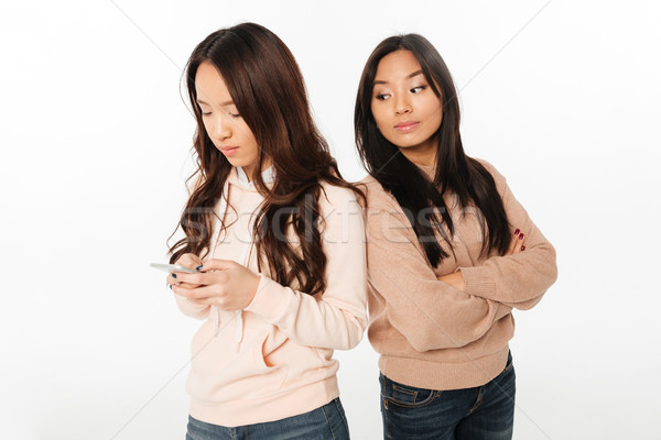 Asian woman looking at her sister Stock photo © deandrobot