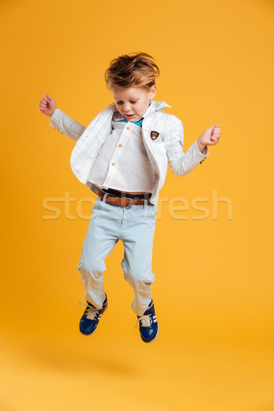 Little boy child jumping Stock photo © deandrobot