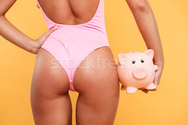 Back view close up of woman's buttocks in swimsuit Stock photo © deandrobot