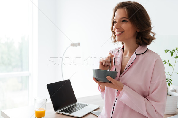 肖像 かなり 若い女の子 パジャマ 朝食 キッチン ストックフォト © deandrobot