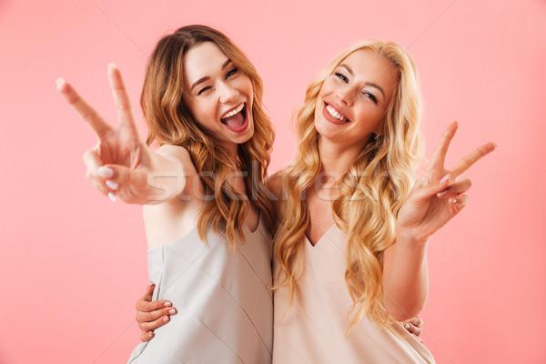 Dwa szczęśliwy dość kobiet piżama stwarzające Zdjęcia stock © deandrobot