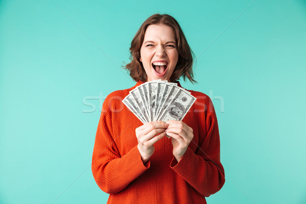 Portrait of a happy young woman dressed in sweater Stock photo © deandrobot