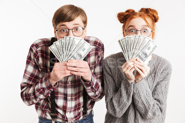 Funny couple of school nerds holding bunch of money Stock photo © deandrobot