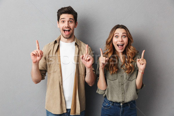 Portrait of a cheerful young couple standing together Stock photo © deandrobot