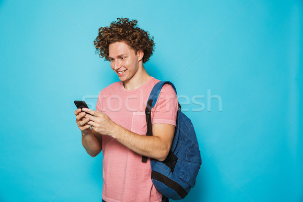 Photo of caucasian hipster guy with curly hair wearing casual cl Stock photo © deandrobot