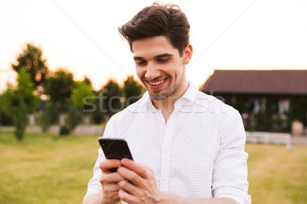 изображение счастливым молодым человеком белый рубашку Сток-фото © deandrobot