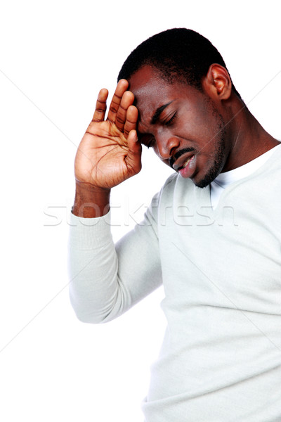 Retrato africano homem dor de cabeça isolado branco Foto stock © deandrobot