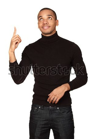 Young african-american handsome man pointing and looking up isolated on white background Stock photo © deandrobot