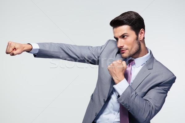 Businessman punching  Stock photo © deandrobot