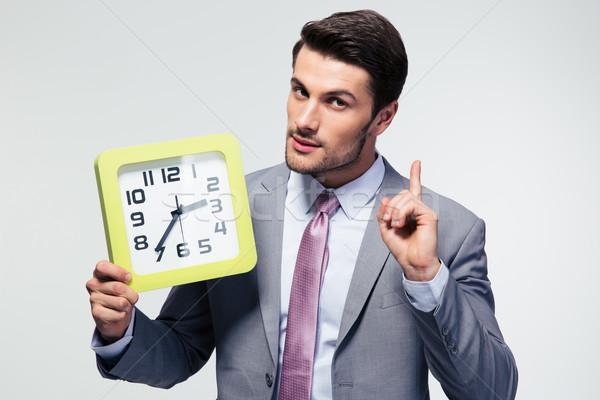 Stock photo: Businessman holding clock