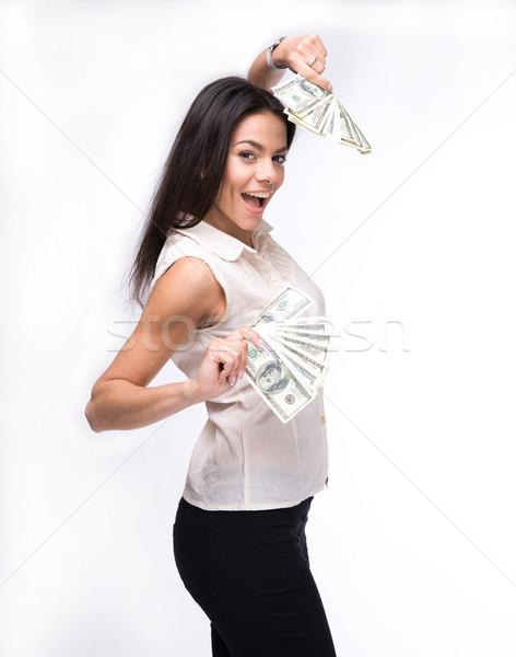 Cheerful businesswoman holding US dollar bills Stock photo © deandrobot