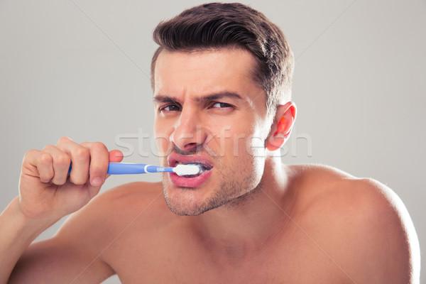 Portret knappe man grijs naar camera Stockfoto © deandrobot