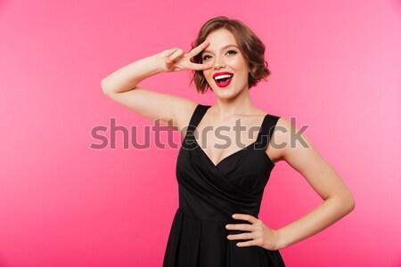 Boos vrouw bikini roze naar Stockfoto © deandrobot