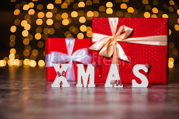 Xmas white decorated text and present boxes Stock photo © deandrobot